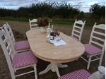 Picture of Grand Dining Table With 6 Large Upholstered Chairs