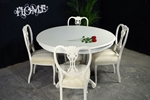 Picture of Round Louis style table with 4 Antique Lattice Back chairs